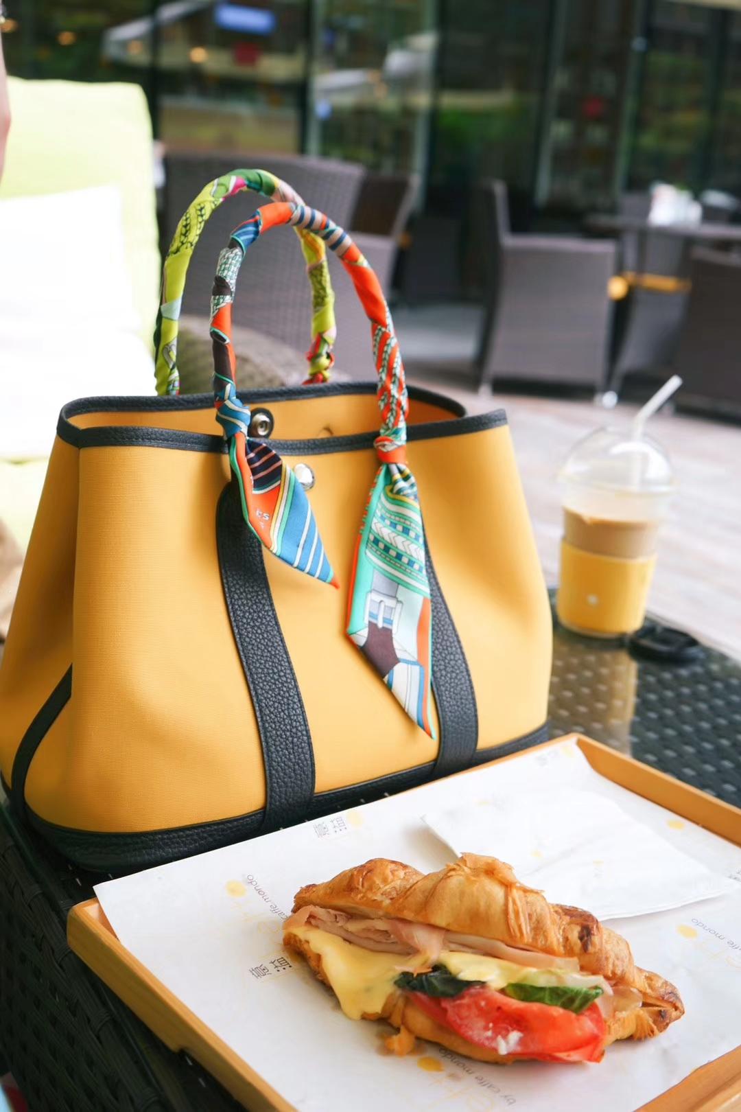 Hermès(爱马仕)garden party 花园包 黑色togo拼琥珀黄帆布 30CM